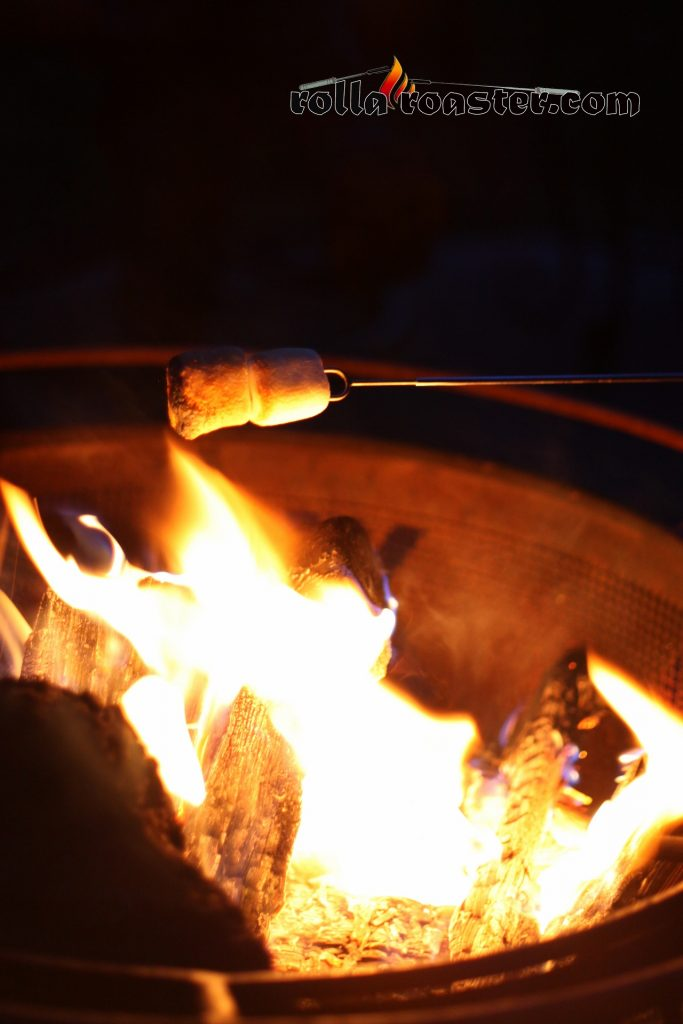 Toasting marshmallows over a campfire with Rolla Roasters.