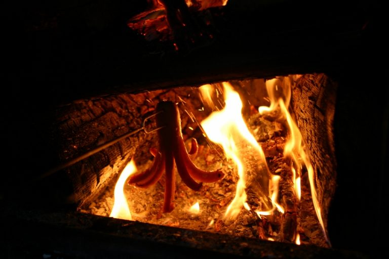 "The ""legs"" of the octopus weiner curling up in the fire while toasting with a Rolla Roaster."